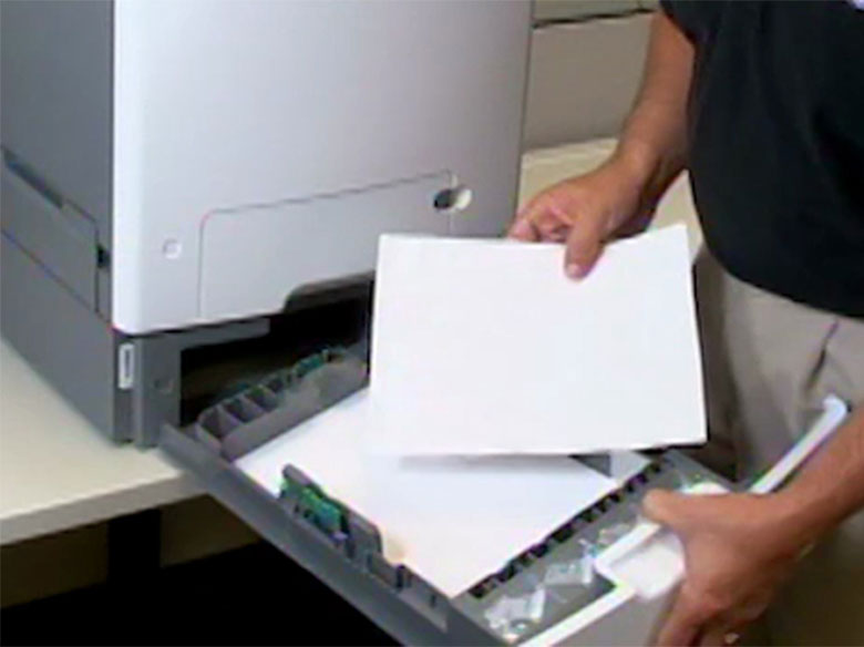 Remove the jammed paper in one of the optional trays