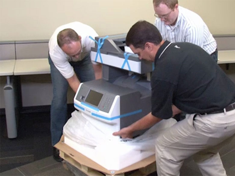 Lift the printer away from the packaging