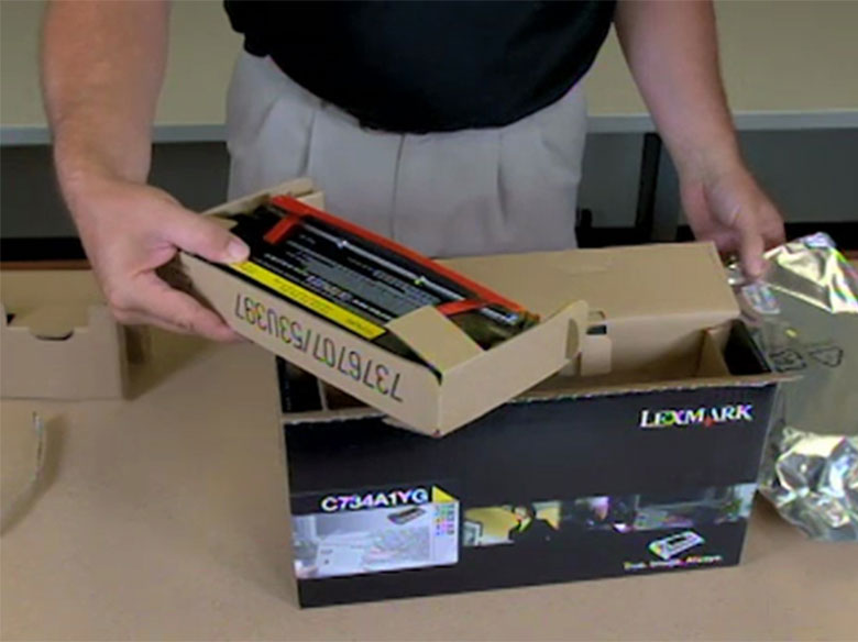 Unpack the new toner cartridge