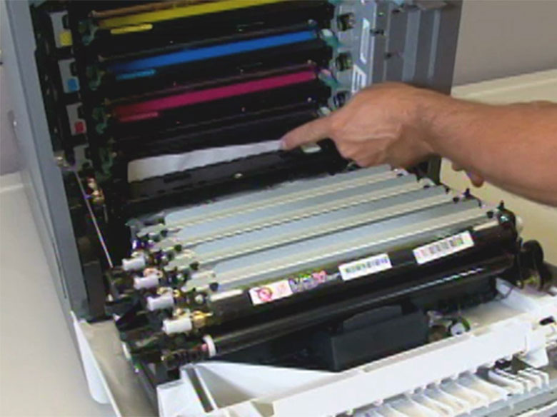 Remove the paper jam in front of the toner cartridge