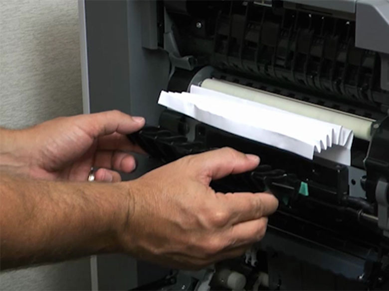 Remove the jammed paper in the fuser