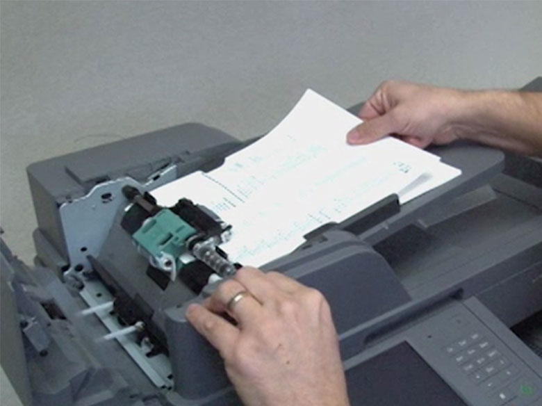 Remove the jammed paper from the ADF