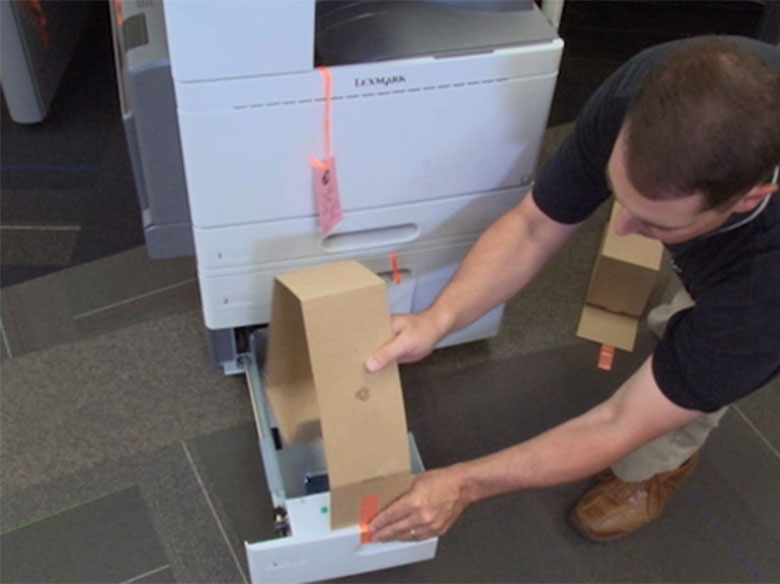 Remove all internal packaging, insert the toner cartridges, and adjust the stabilizing pads