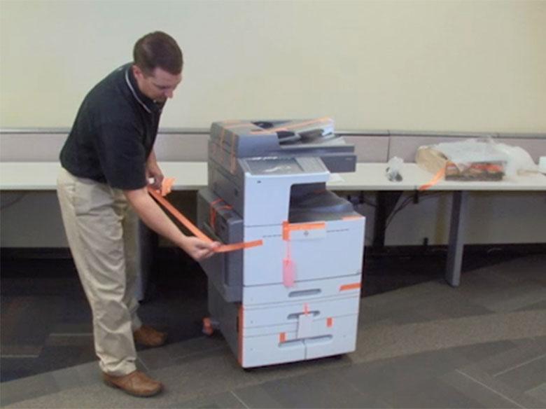 Retirar el precinto de la impresora