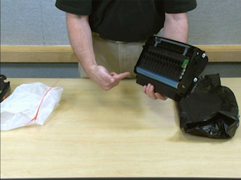 Remove the toner cartridge and insert it into the new photoconductor kit