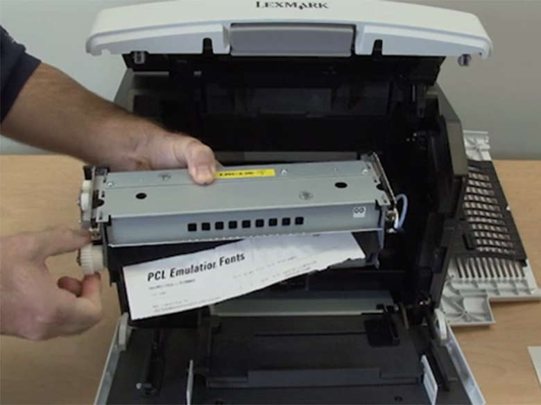 Remove the jammed paper from the fuser kit