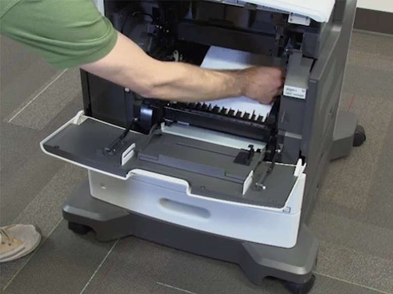 Remove internal jams behind the toner cartridge and imaging unit