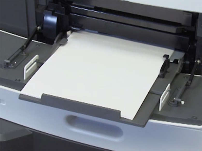 Load paper for two‑sided (duplex) printing ‑ with stapler