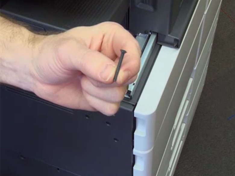 Attach screws to lock in the staple finisher