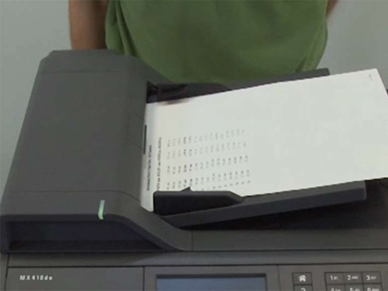 Load paper into the automatic document feeder (MX310)
