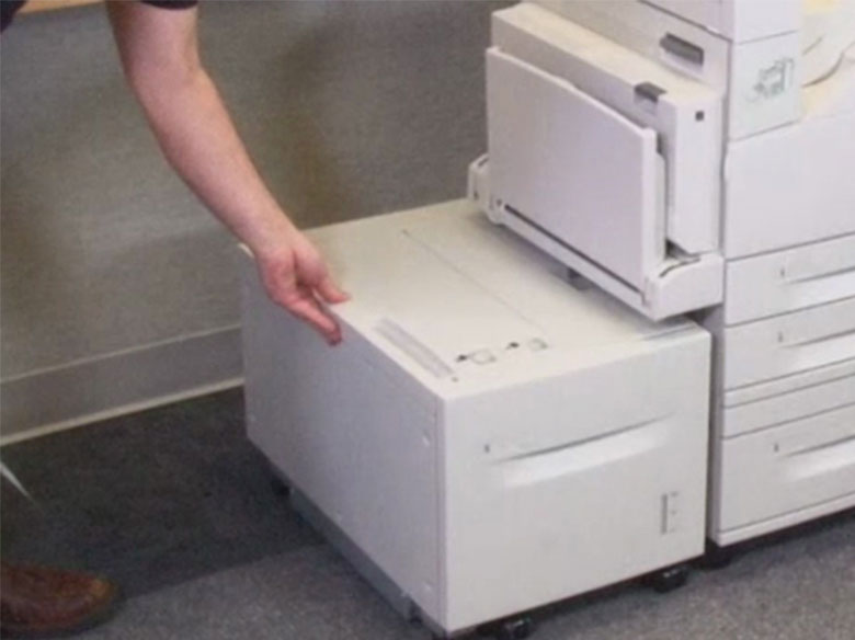 If the printer has a high‑capacity input tray, then slide it in
