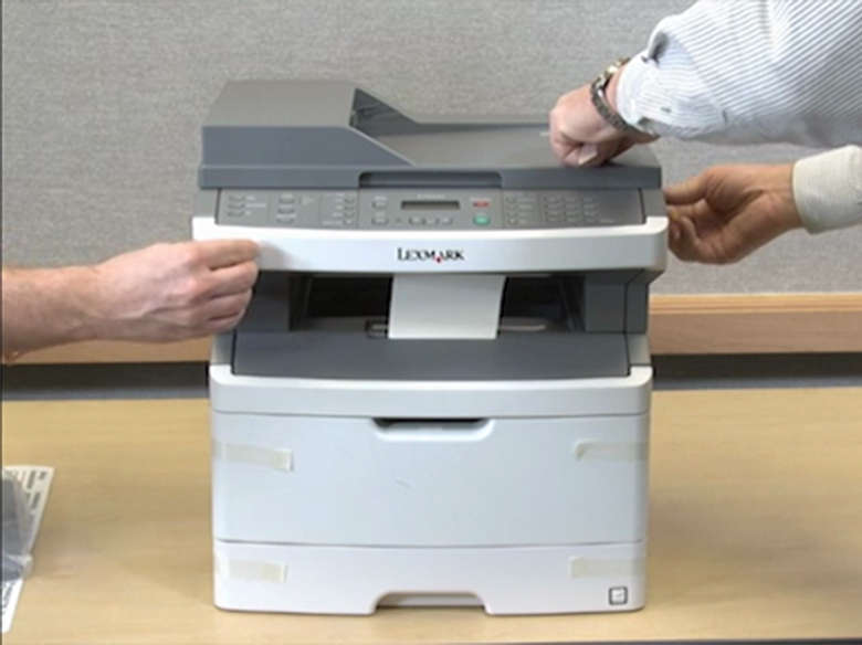 Remove the protective tape and packaging from the printer