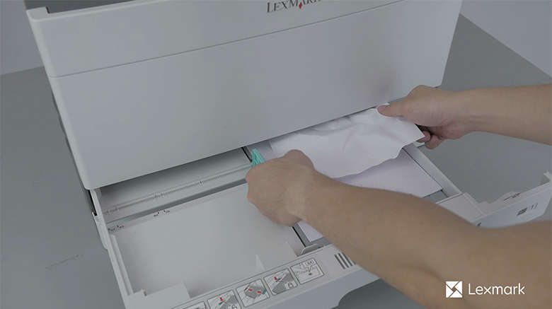 Remove the jammed paper in the tray