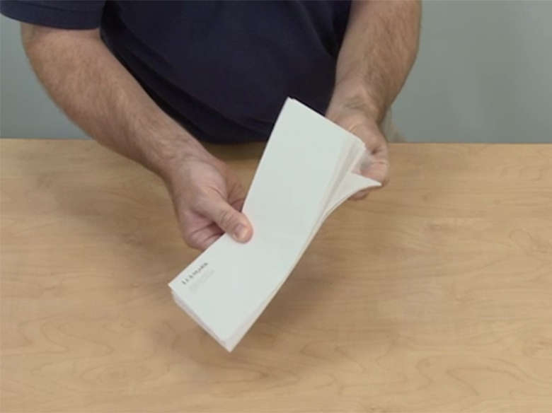 Flex the envelopes back and forth to loosen them